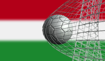 Soccer ball scores a goal in a net against Hungary flag. 3D Rendering