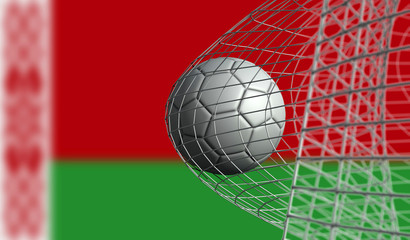Soccer ball scores a goal in a net against Belarus flag. 3D Rendering
