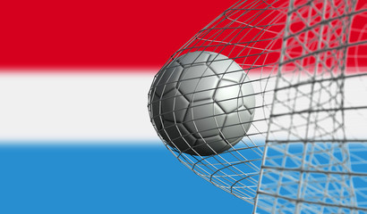 Soccer ball scores a goal in a net against Luxembourg flag. 3D Rendering