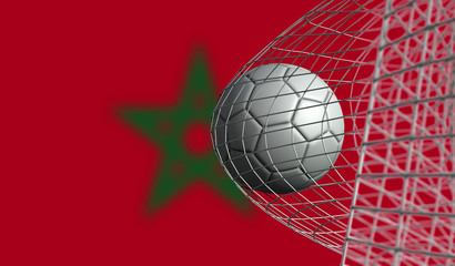 Soccer ball scores a goal in a net against Morocco flag. 3D Rendering
