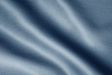Fototapeta texture of dark blue fabric with large diagonal folds, abstract background obraz