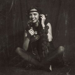 Woman 1920s style with old phone. Vintage style photography with reconstructed artifacts