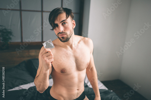 Handsome guy gets condom sex