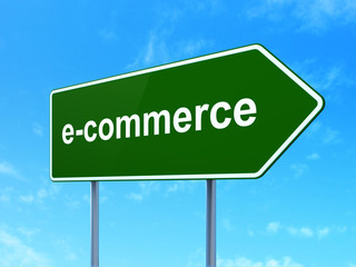 Finance concept: E-commerce on road sign background