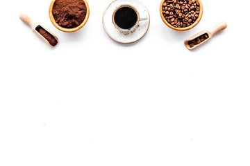 Coffee concept. Roasted beans, ground coffee, cup of espresso on white background top view copyspace