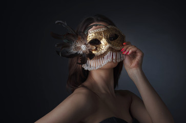 Beautiful woman with carnival mask.