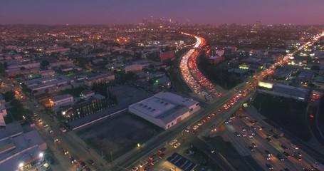 Fotobehang - Aerial view rush hour traffic 101 Freeway Los Angeles California night 4K UHD