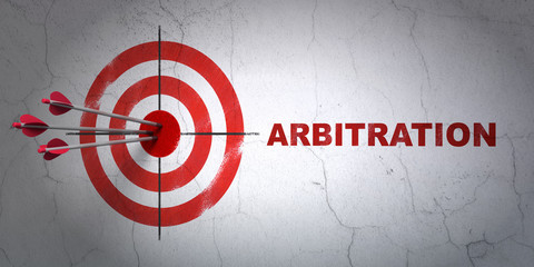 Law concept: target and Arbitration on wall background