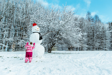 little kid run to snowman