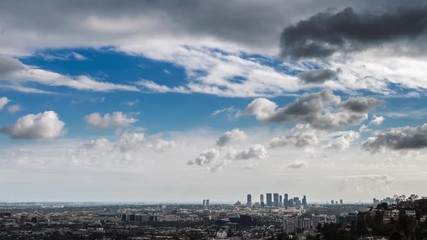 Fototapete - Beautiful storm clouds passing over city of Los Angeles skyline 4K timelapse