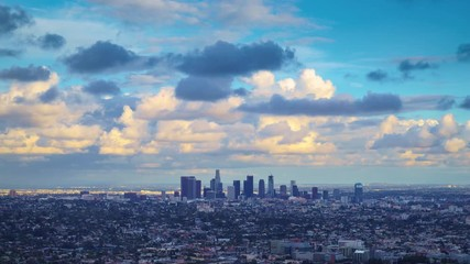 Fototapete - Dramatic storm clouds passing over city of Los Angeles skyline 4K UHD Timelapse