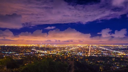 Fototapete - Dramatic storm clouds passing night  city Los Angeles skyline Zoom in Timelapse