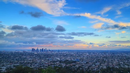Fotobehang - Storm clouds passing city Los Angeles skyline changing day night Zoom in 4K UHD