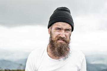 Hipster with long beard hair, mustache on bearded face