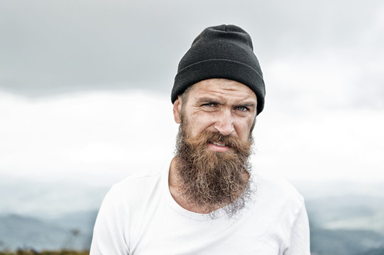 Hipster with long beard hair, mustache on bearded face