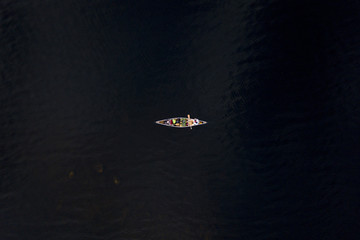 From an aerial perspective, two men canoe and fish alone on Somerset Reservoir in Southern Vermont during the summer.