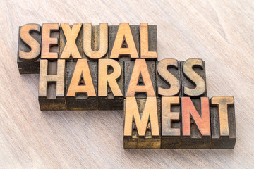 sexual harassment word abstract in wood type