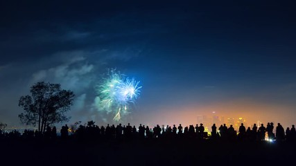 Fotobehang - Crowd people silhouettes watching fireworks display show on 4th of July. 4K UHD.