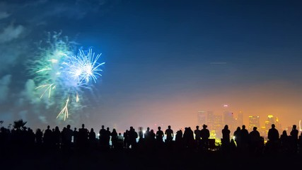 Fotobehang - Crowd people silhouettes watching fireworks display show 4th of July Los Angeles