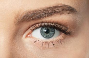 Female eye with long eyelashes, closeup
