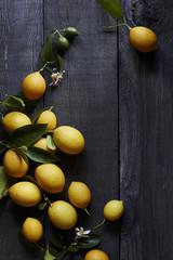 Ripe Meyer lemons on wooden table