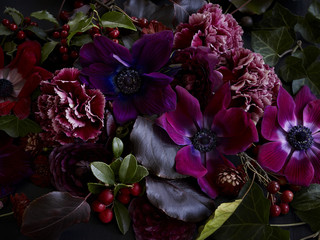 Winter flowers with hollies, anemones and carnations