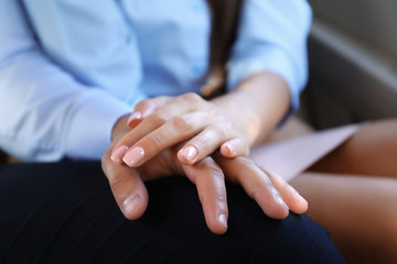 Young couple holding hands together, closeup