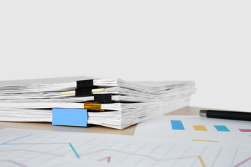 Documents on table against light background