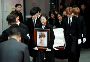 A portrait and the coffin of Kim Jong-hyun, the lead singer of top South Korean boy band SHINee, is carried during his funeral at a hospital in Seoul, South Korea