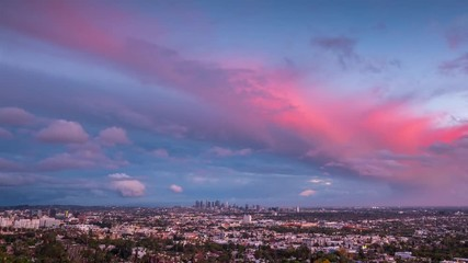 Fotobehang - Red orange storm clouds city Los Angeles skyline cityscape at sunset timelapse