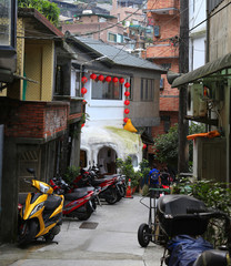 Jiufen, North Taiwan - June 6 2017 : Homes, buildings, shops and streets of Jiufen district shows scooters as their main mode of transport.