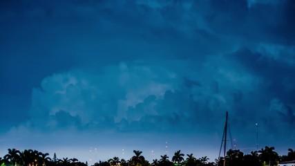 Fotobehang - Thunder storm clouds lightning bolts flashing at night. 4K timelapse.