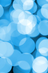 Blue Festive Christmas elegant abstract background with many bokeh lights. Defocused artistic image