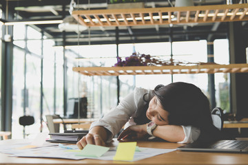 tired businesswoman sleep at office. exhausted woman dozing at workplace. overwork, fatigue concept