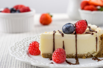 Delicious cheesecake with strawberry and blueberry on a table top view.