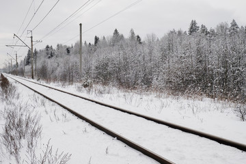 snow-covered train tracks in the suburbs