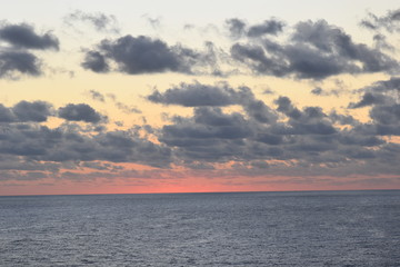 The Clouds and Sun Rising over the Ocean
