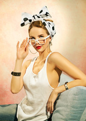 Pin-up girl sitting on the sofa