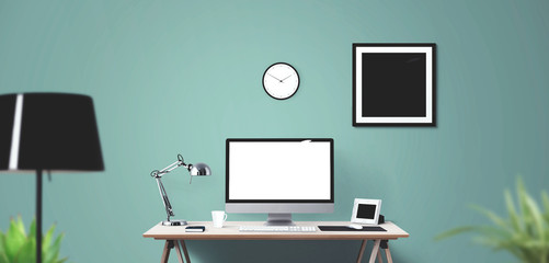 Computer display and office tools on desk.