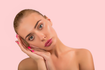 Portrait of a beautiful nude female girl model big lips on beige background spa