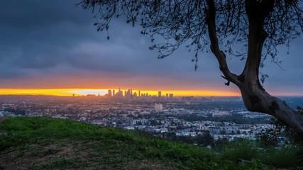 Fotobehang - Epic cloudy sunrise over city of Los Angeles cityscape skyline 4K Timelapse
