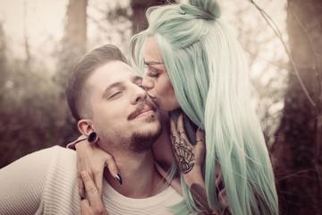 Kissing and loving.