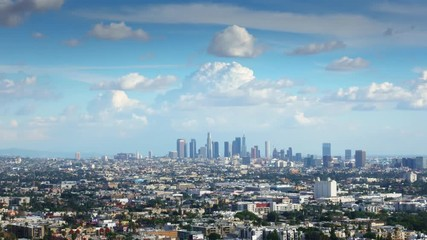 Fototapete - White clouds in blue sky over city of Los Angeles skyline. 4K Timelapse.