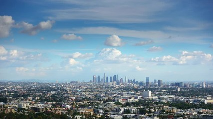 Fototapete - White clouds in blue sky over city of Los Angeles cityscape. 4K UHD Timelapse