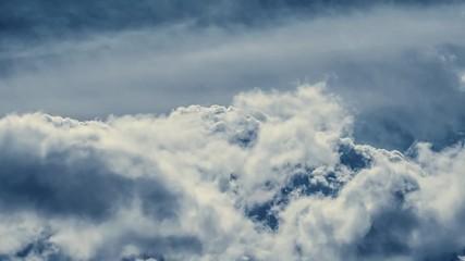 Fotobehang - Epic gloomy storm clouds moving fast over dark blue sky background. 4K Timelapse