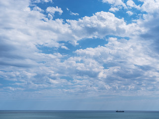 Calm sea and cloudy sky. Nature background.