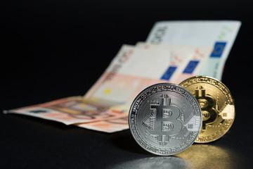 Bitcoins and euro banknotes money
