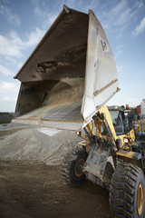 Wall Mural - Excavator moving sand and gravel