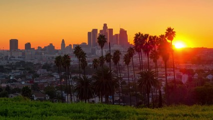 Fotobehang - Sunset over downtown of city of Los Angeles skyline. 4K UHD Timelapse