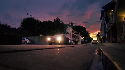 Fotobehang - Traffic on residential street at sunset in West Hollywood Los Angeles California
